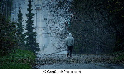 Man Walking On Cold Wet Day - Man walks in rainy weather on...