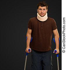 Man Walking On Crutches With Neck Brace