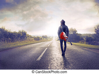 Man walking on empty freeway
