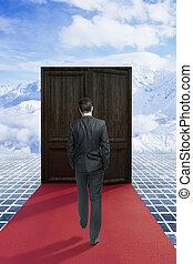 man walking on red carpet to success