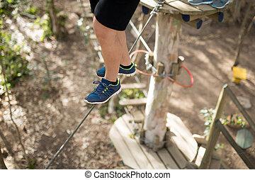 Man walking on rope