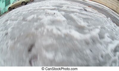 man walking on snow and mud early spring gopro video about...
