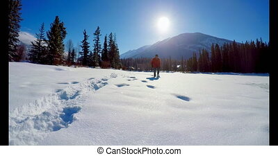 Man walking on snowy landscape 4k - Man walking on snowy...