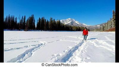 Man walking on snowy landscape 4k - Man walking on snowy...