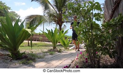 Man Walking on Stone Paved Footpath in Tropical Africa