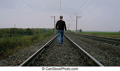 Man walking on the railroad