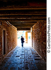 Man Walking out of Tunnel