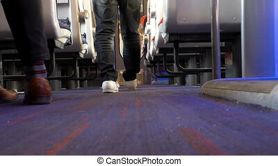 Man walking through passenger train car door