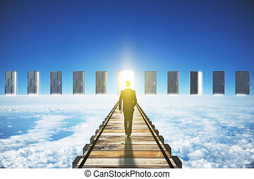 Man walking to an open door in clouds concept
