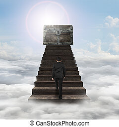 Man walking toward treasure chest on top of wood stairs