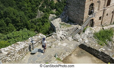 Man walking up tourist path in mountains