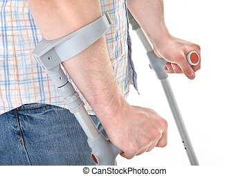 man walking with a crutch against white background