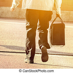 Man walking with business bag