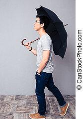 Man walking with umbrella