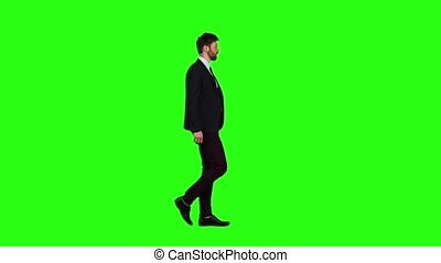 Man walks calmly down the street, he is happy. Green screen. Slow motion
