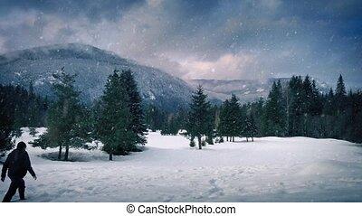 Man Walks Near Mountain In Snowfall