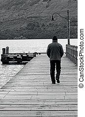 Man walks on a wharf