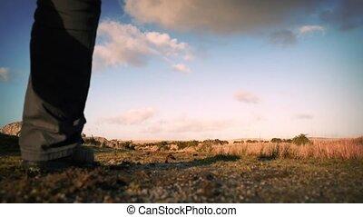 Man Walks On Hilltop