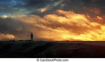Man Walks On Horizon With Epic Sky