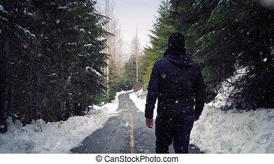 Man Walks On Road In Snowfall