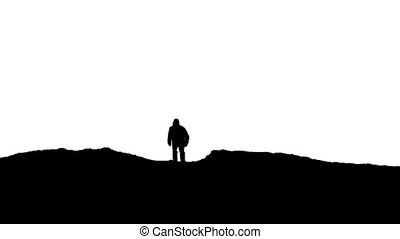 Man Walks Over Hill Silhouette