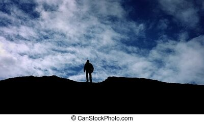 Man Walks Over Hill Top Silhouette - Silhouette of man...