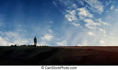 Man Walks Past Dramatic Sky