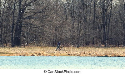 Man walks with a Bicycle