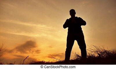 man warrior martial arts monk practicing silhouette karate...