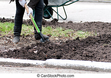 man was digging the ground with a shovel
