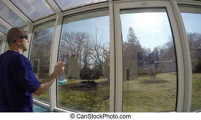 man wash spray window