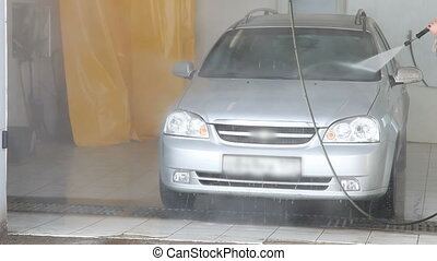 Man washing a car