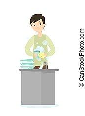 Man washing dishes.