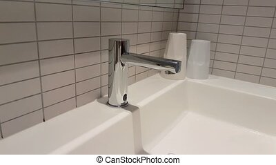 Man Washing Hands With Automatic Faucet - Man Washing Hands...