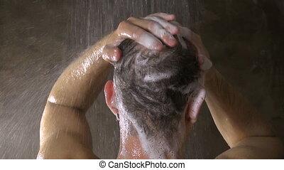 man washing his hair 30