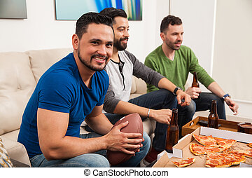 Man watching a game with his friends