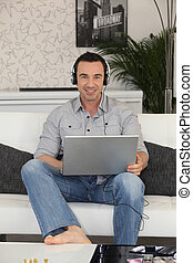 Man watching a movie on laptop