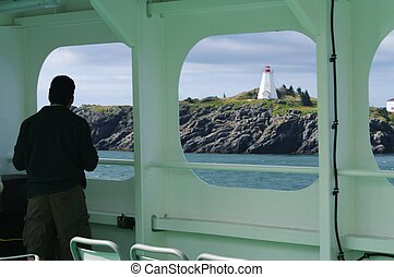 Man watching Lighthouse on the shore