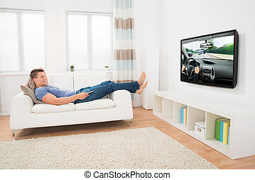 Man Watching Movie At Home