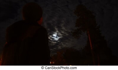 man watching on full moon at night horror scene