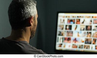 man watching sex site at night