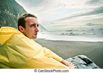 Man watching the ocean