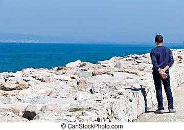 Man Watching The Sea