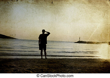 man watching the sunset on beach