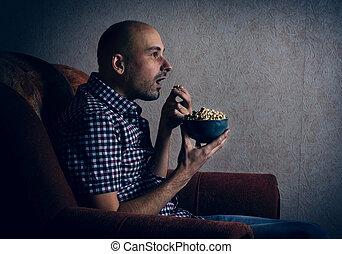 man watching tv at night.