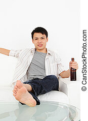Man watching TV with beer