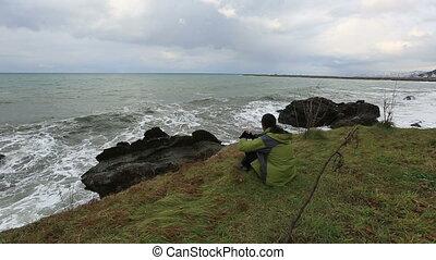 man watching wave crash