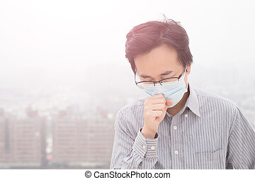 man wear masks with air pollution, asian