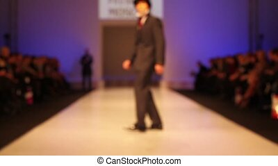 Man wear suit and top hat from walk the catwalk, out of...
