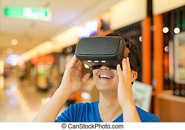 man wear virtual reality headset happily, asian